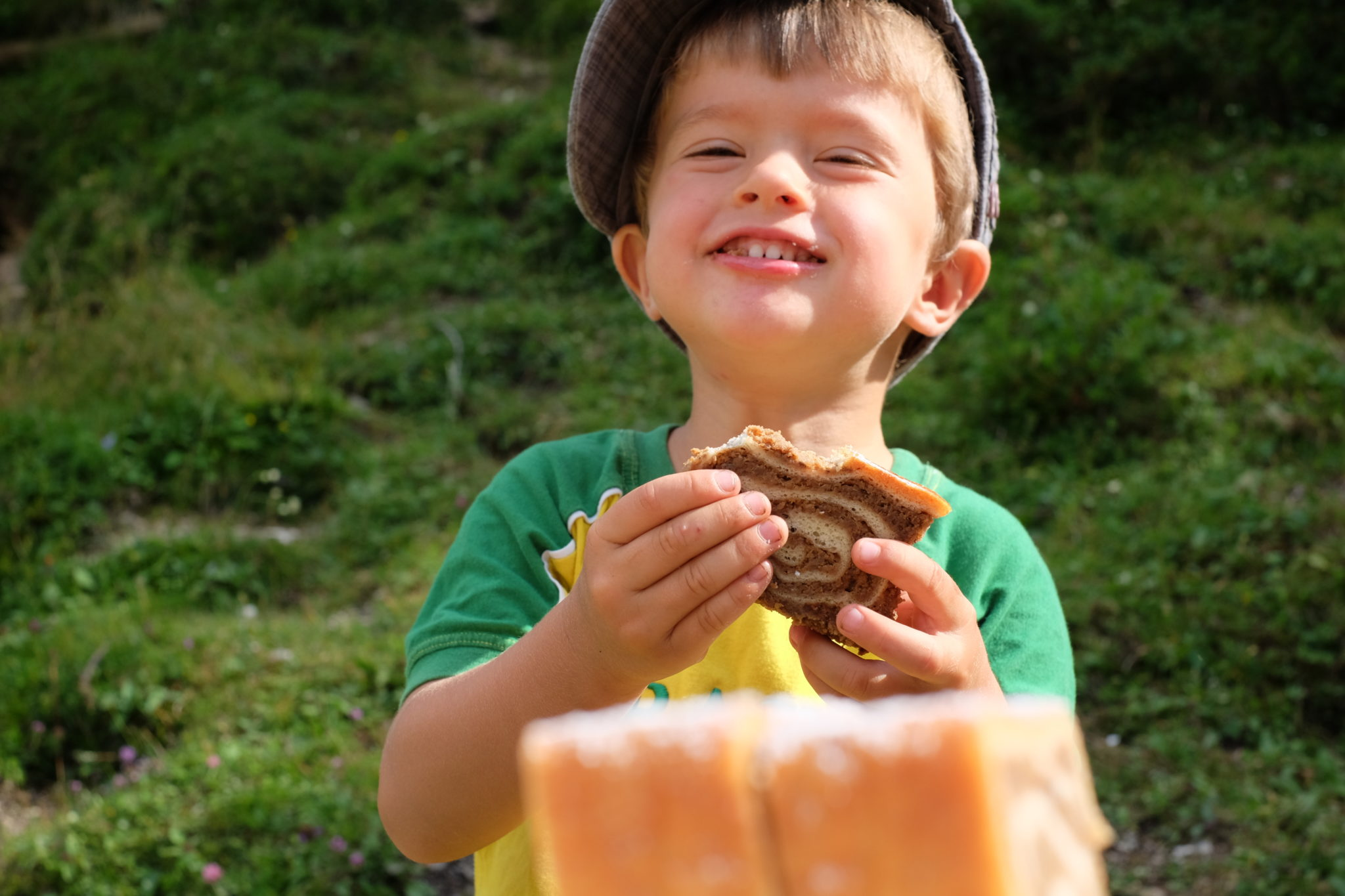 After a 3-hour hike towards Mt. Debela Peč, 6,600 Ft or 2,014 m, he was thrilled to get a piece of a traditional Slovenian pastry, potica. Photo by: Exploring Slovenia.