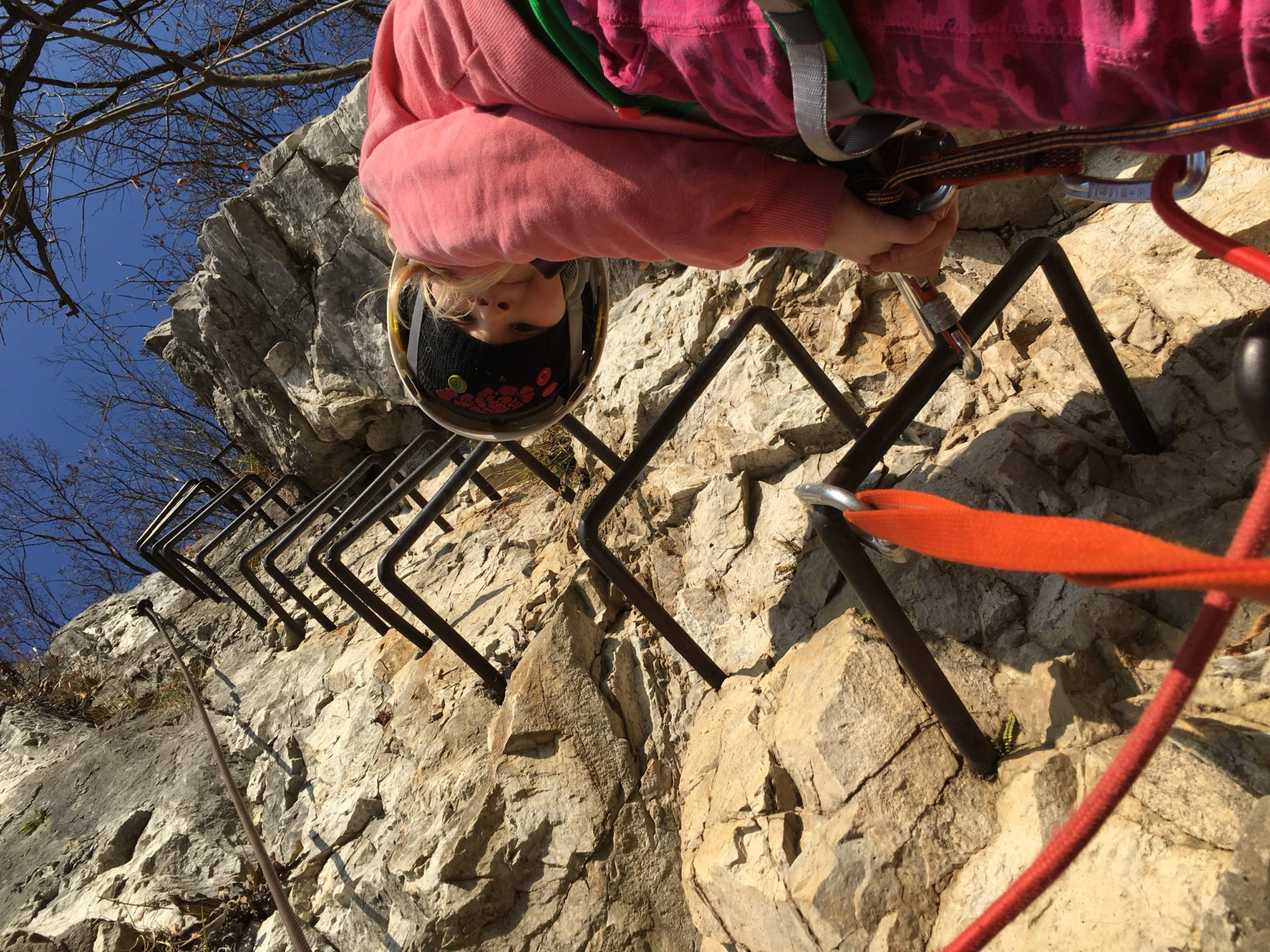 Kids love climbing via ferrata, but make sure you use recommended safety gear like a helmet, a lanyard protection system, and a harness. Photo by: Exploring Slovenia.