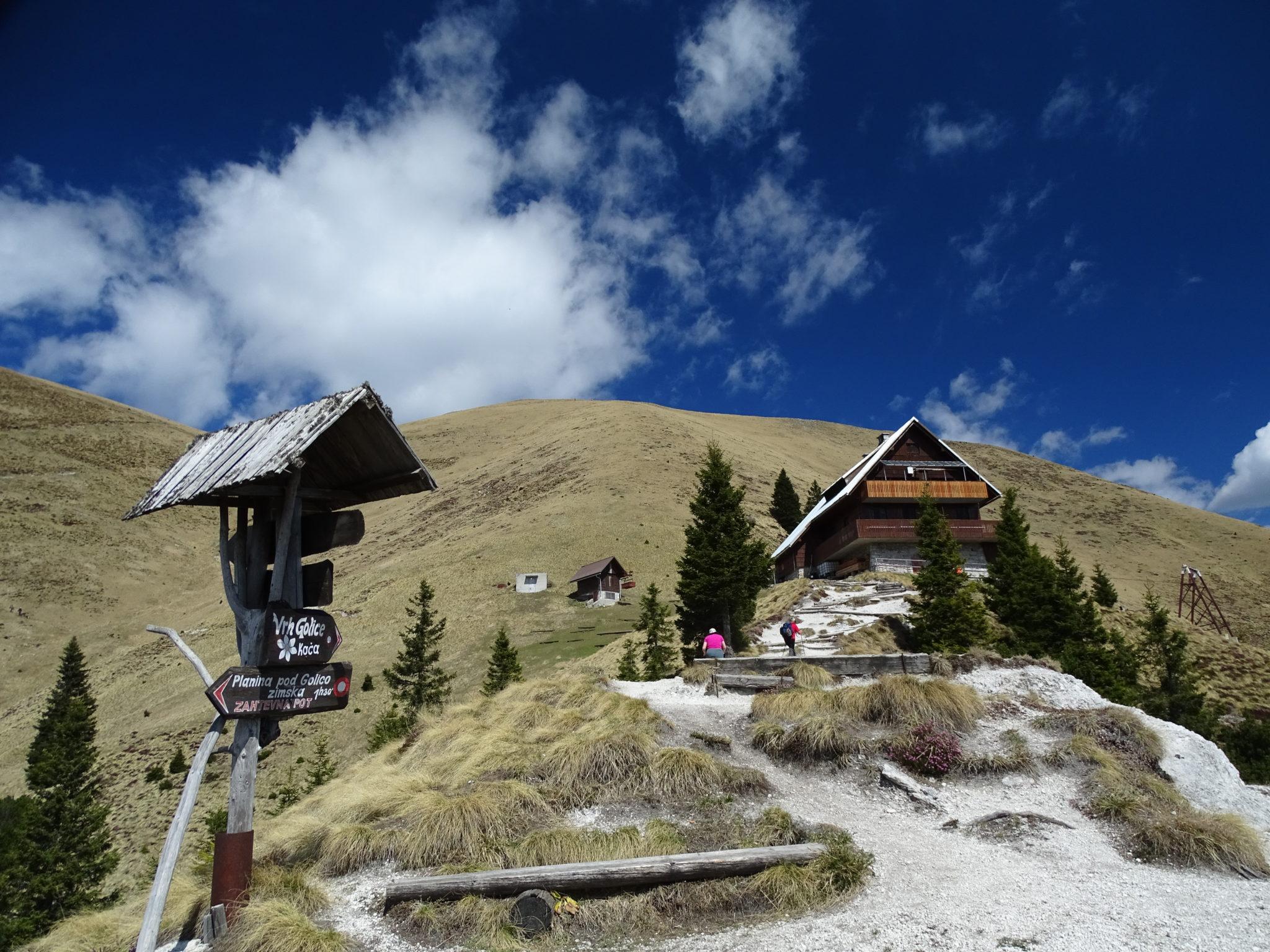 A mountain hut, mountains, sun