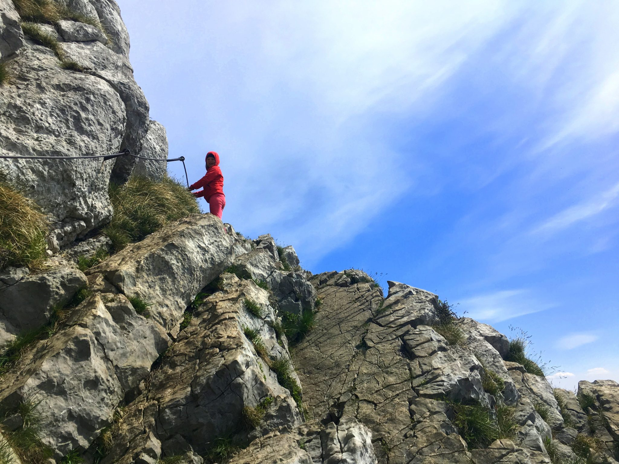 A little girl climbing a mountain