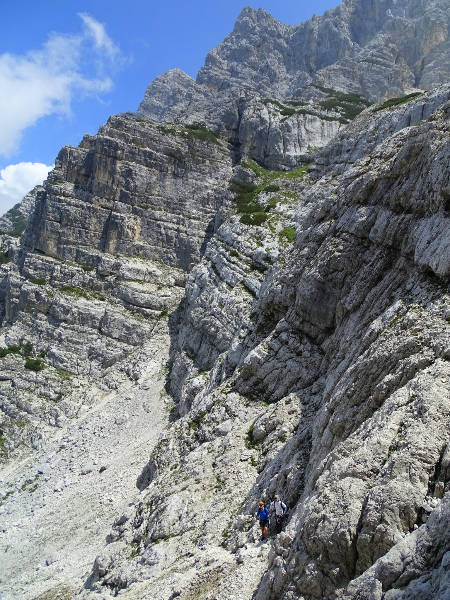 Two hikers going up to Triglav over the Prag Route