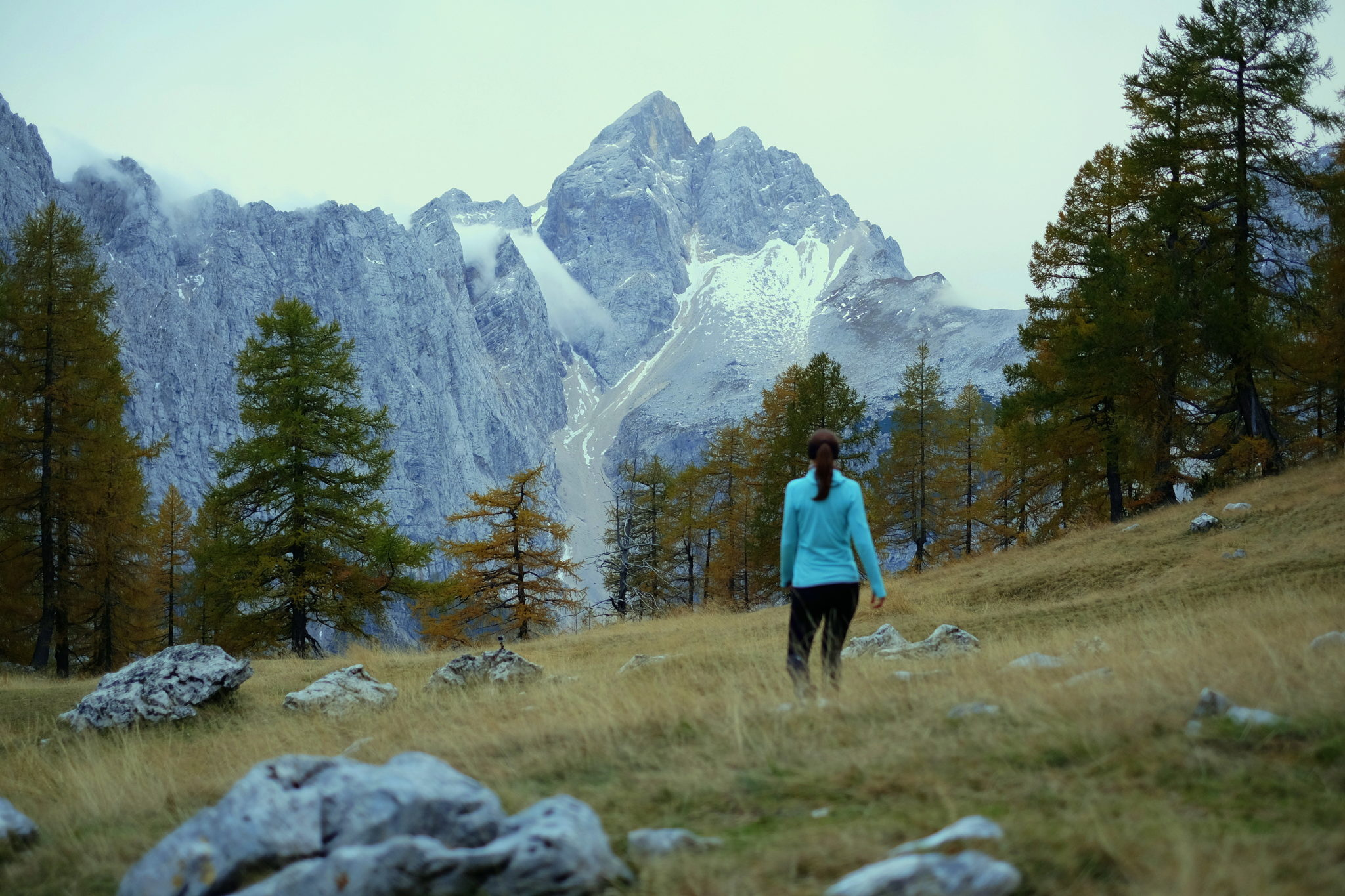 A female hiker looking Jalovec from Sleme, above Kranjska Gora, Slovenia