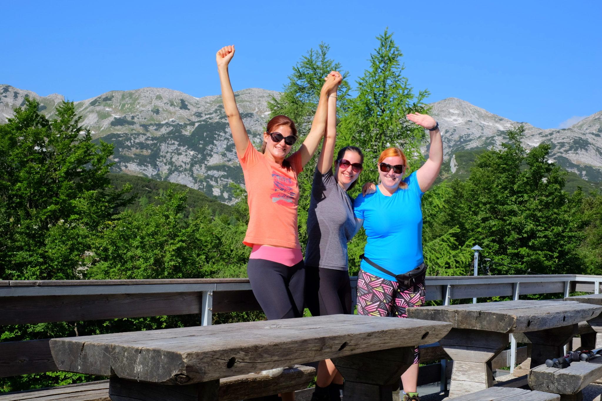 Three women hikers happy at the Komna hut, Julian Alps, Slovenia
