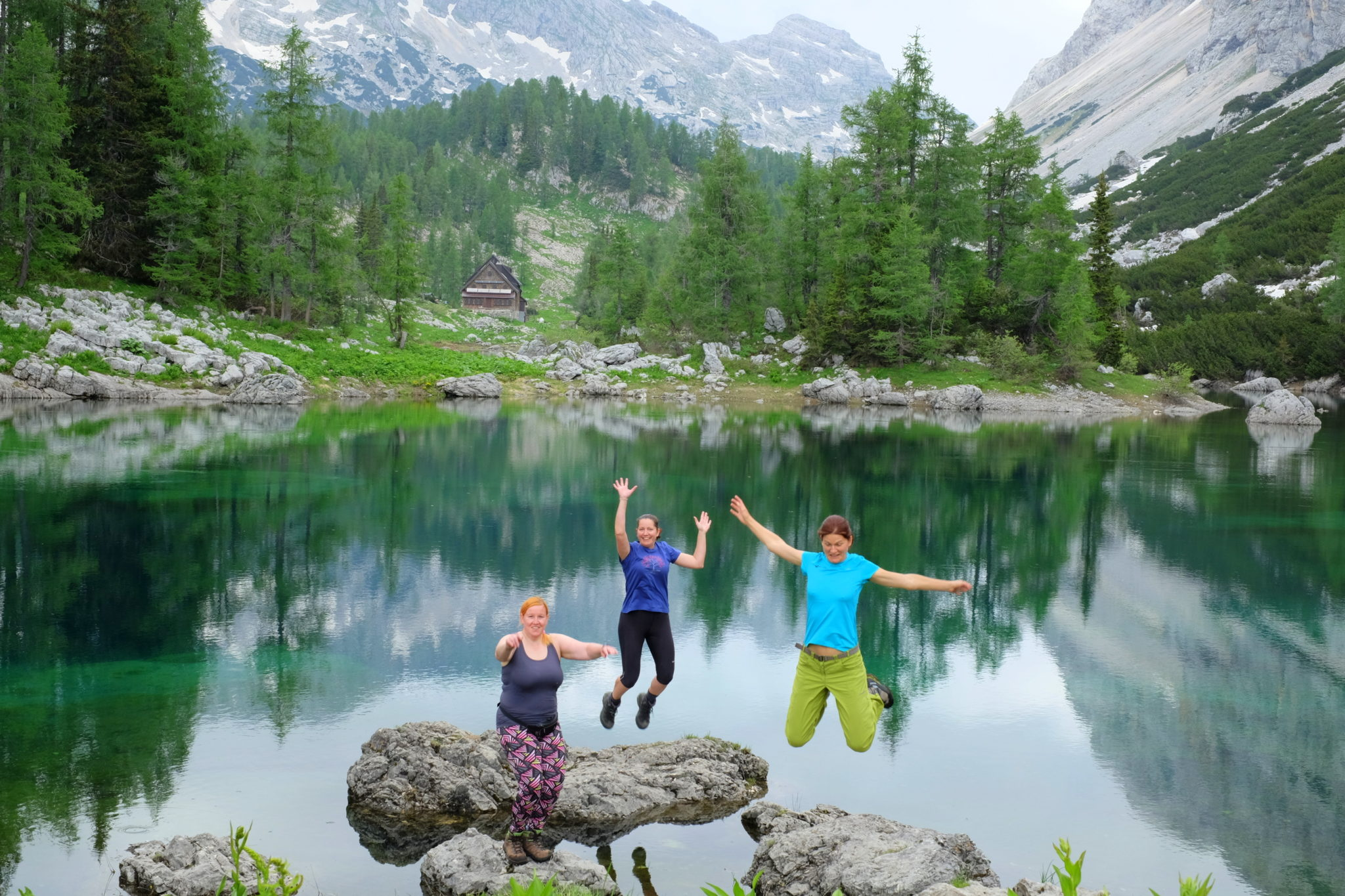 Three women by the Double Lake of the Triglav Lakes, Slovenia, Triglav National Park