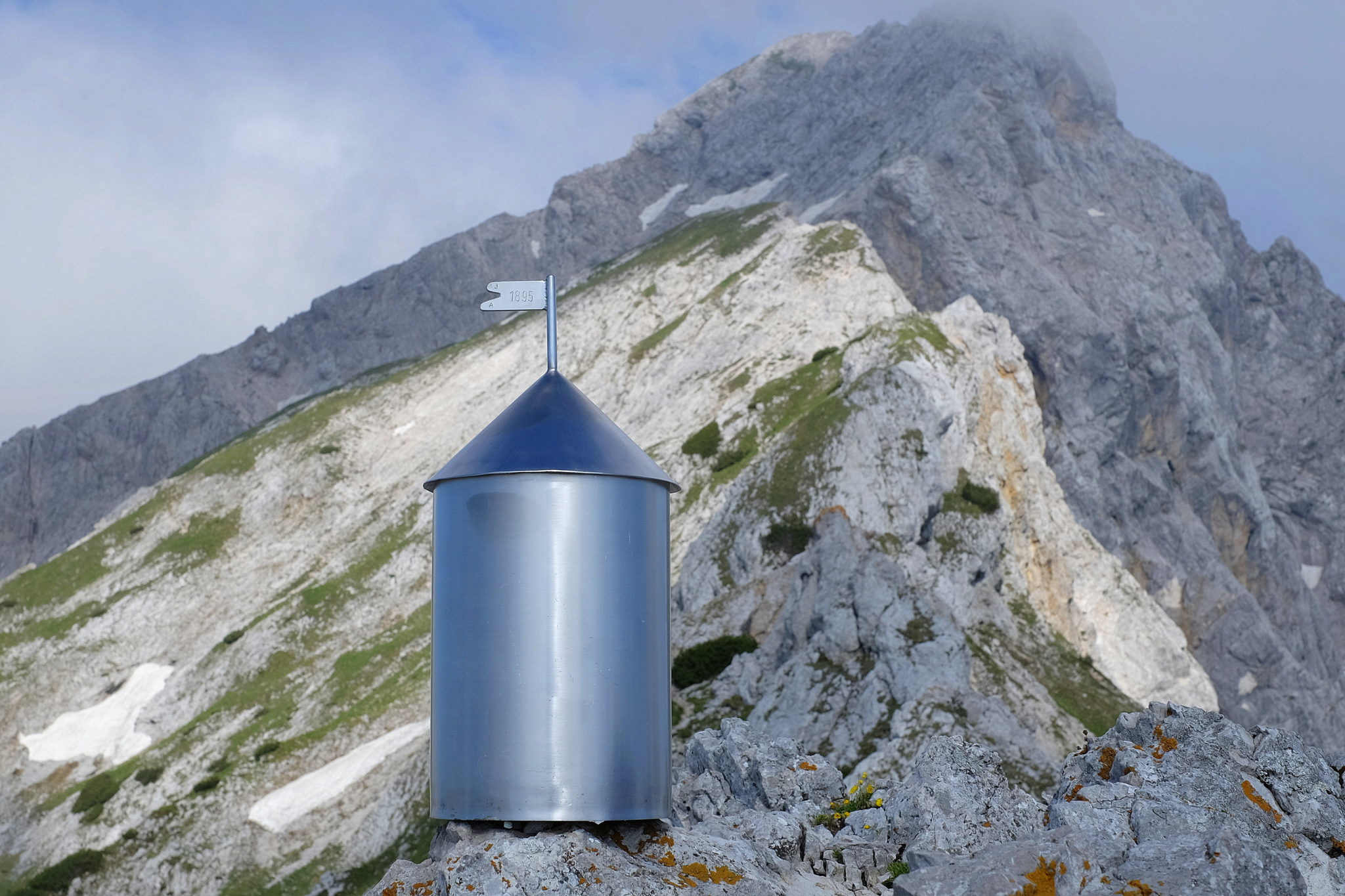 While one of the few miniature Aljaž Towers in the Slovenian Alps decorates the top of Mala Ojstrica underneath Ojstrica, the real thing sits at the rooftop of Slovenia, Mt. Triglav.