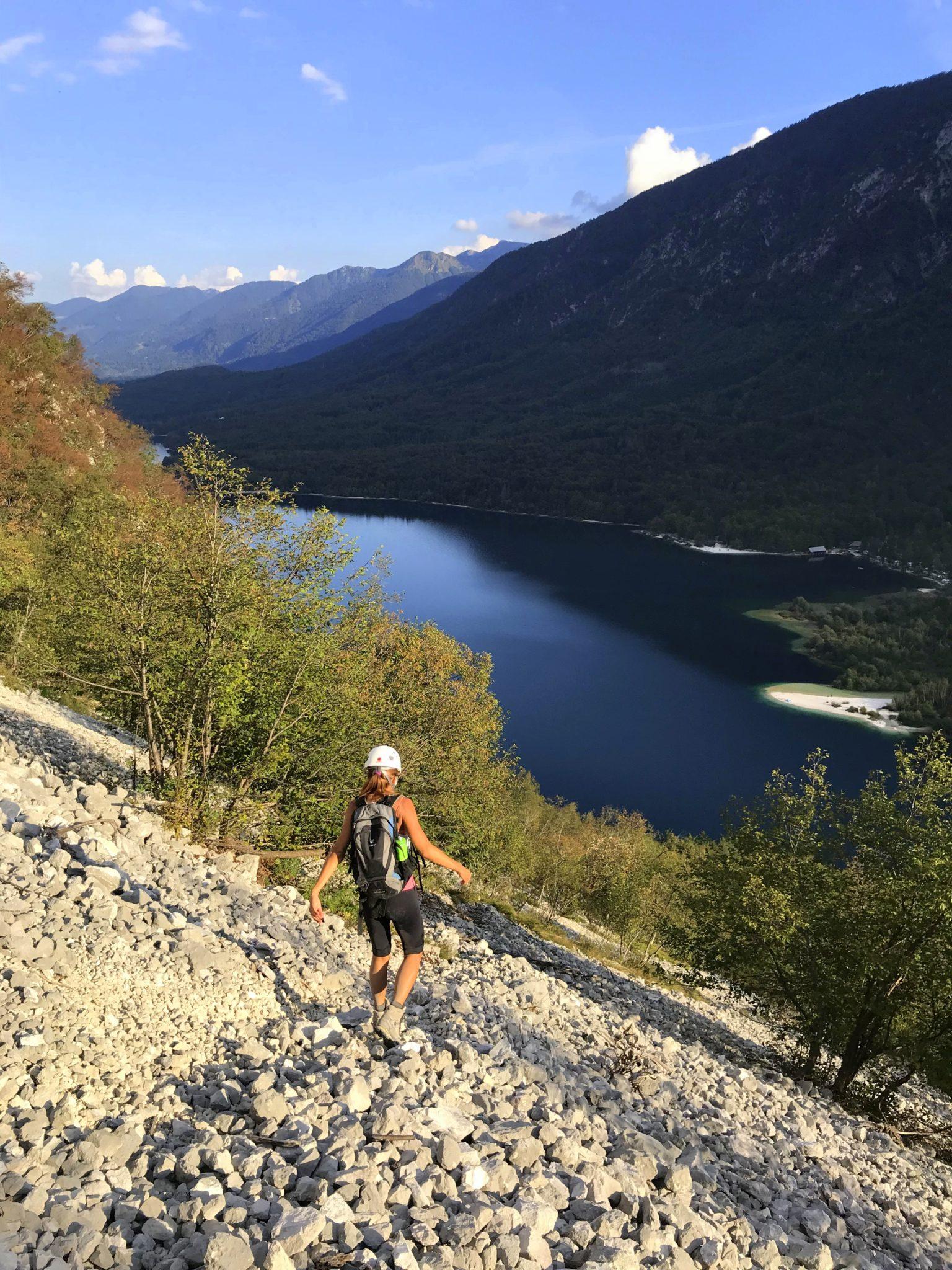 Hiking down the via ferrata Ožarjeni Kamen above Lake Bohinj, Slovenia