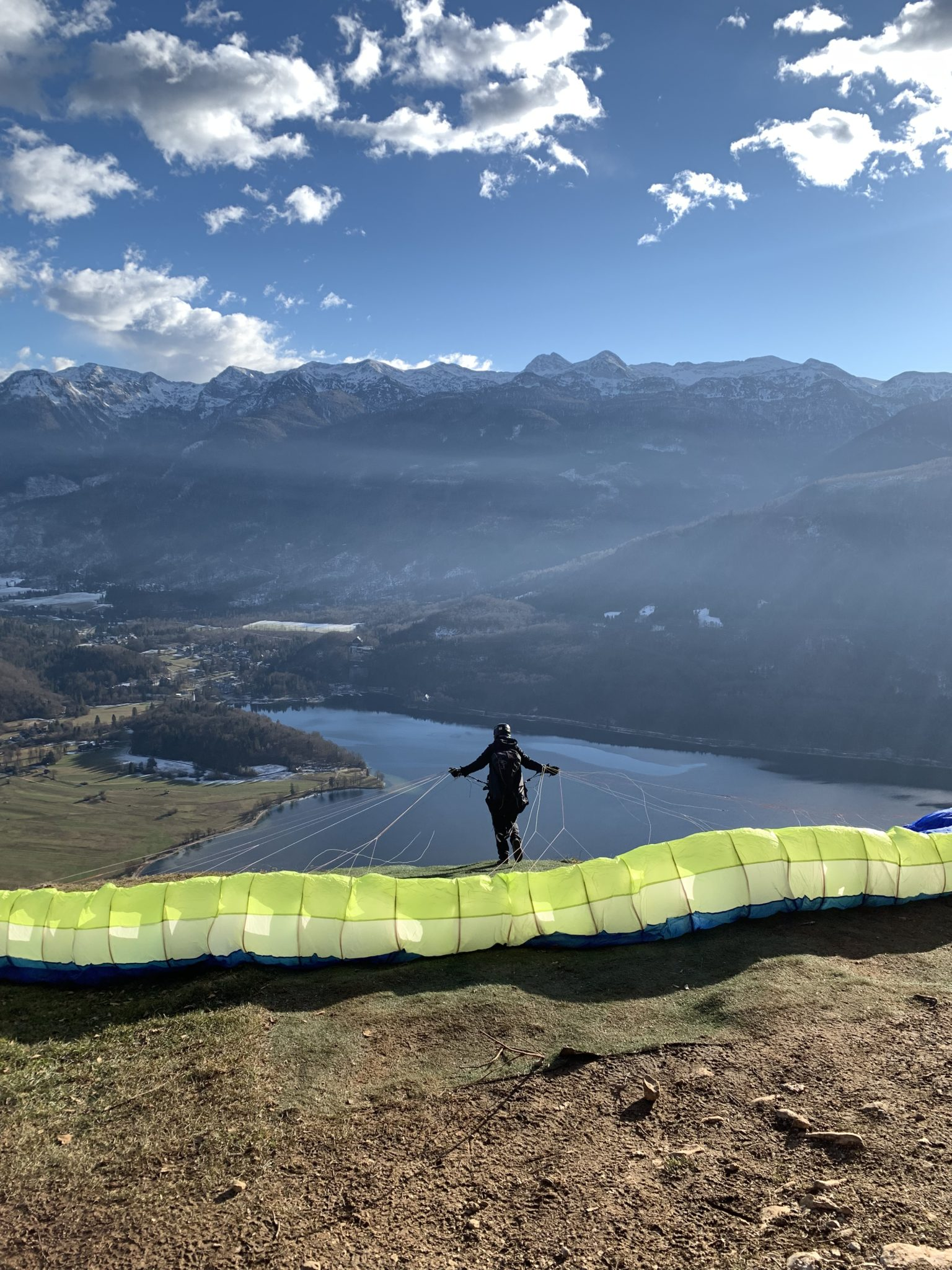 A paraglider taking off above Lake Bohinj, Julian Alps, mountains, Slovenia